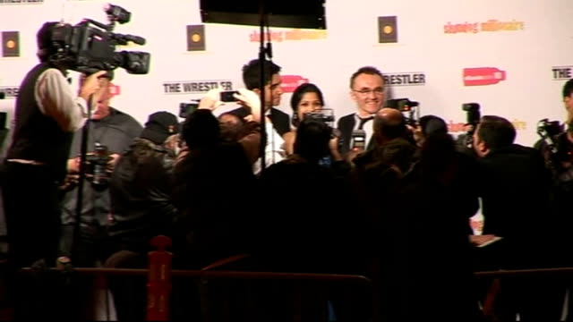 british success at the academy awards 2009 ext / night photography partial view of dev patel freida pinto and danny boyle posing for group photocall... - oscar party stock videos & royalty-free footage