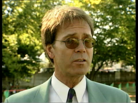 british summer itn ms sir cliff richard along sir cliff richard interviewed sot even if it was a dull day we've had some great tennis this week i/c - cliff richard stock videos and b-roll footage