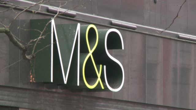 british supermarket chain marks and spencer vows not to use cotton from china's xinjiang region in its clothes in response to the country's alleged... - catena di negozi video stock e b–roll