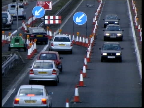 ros scotland edinburgh m8 motorway ext gvs traffic along past traffic cones during roadworks - roadworks stock videos & royalty-free footage