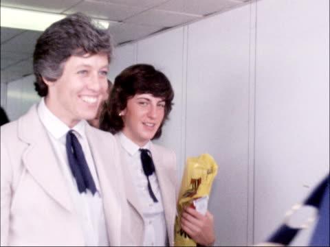 vídeos de stock, filmes e b-roll de british team depart from heathrow; england: london: heathrow airport: ext sebastian coe , daley thompson l-r along tunnel to plane with others... - sebastian coe