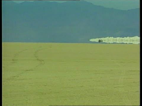 british thrustssc team set new land speed record itn nevada black rock desert ext various thrustssc along pan thrust ssc along during second return... - arid stock videos & royalty-free footage