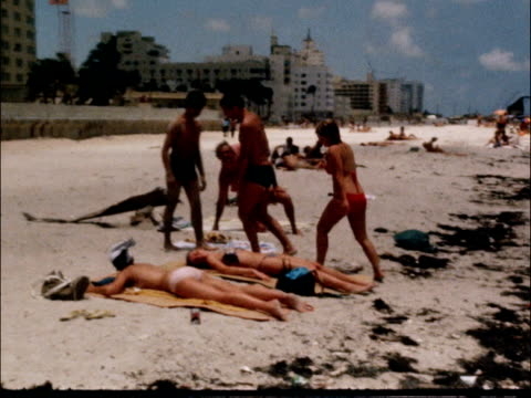 florida miami ext girls in water people on beach earth mover vox pop - miami stock-videos und b-roll-filmmaterial