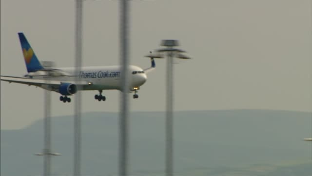 British tourists return home after Foreign Office change travel advice ENGLAND EXT Thomas Cook aircraft approaching runway as coming in to land...
