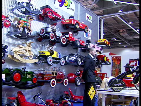 british toy fair at excel exhibition centre: toys displayed; england: london: excel exhibition centre: int anonymous young boy looking at pirate toys... - teddy boy stock videos & royalty-free footage