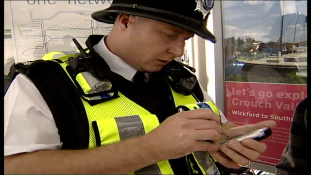 british transport police in london using handheld computers police officer using handheld computer and talking to man hands of police officer using... - electronic organiser stock videos & royalty-free footage