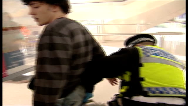 british transport police in london using handheld computers policeman carrying out body search on man who has been randomly stopped pan police... - electronic organiser stock videos & royalty-free footage