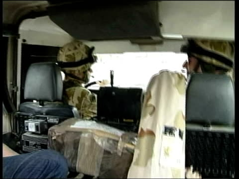 British soldier arrested FILE / TX Southern Iraq British soldier atop tank as along on patrol British soldiers driving patrol vehicle Basra INT...