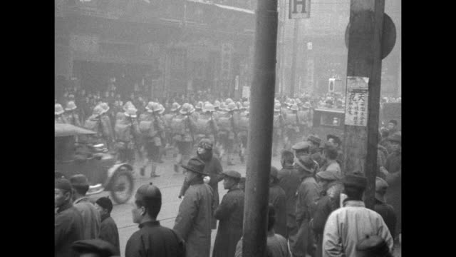 british troops and marching band march near waterfront in chinese city / vs british troops march past in streets bearing bayoneted rifles as... - 1920 stock videos & royalty-free footage
