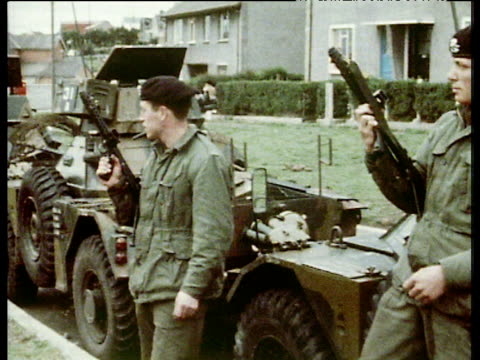 british troops armed with guns standing by military tanks on streets of ulster 1970 - republic of ireland stock videos & royalty-free footage
