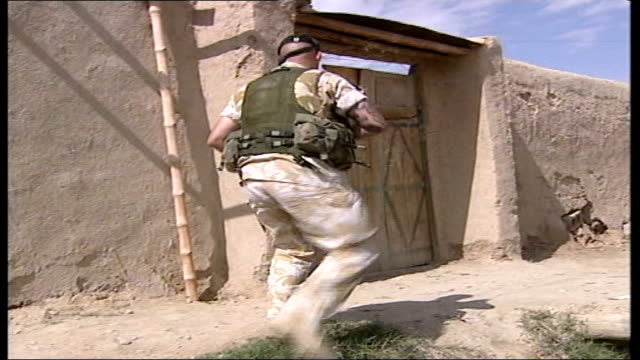 british troops begin patrols in south of country afghanistan helmand province british soldiers on patrol in wasteland area children watching soldiers... - construction vehicle stock videos & royalty-free footage