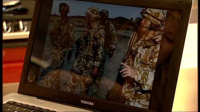 vídeos de stock, filmes e b-roll de british troops deaths in afghanistan: one widow's story; northern ireland: int sequence brenda hale looking at photographs of her late husband on... - widow