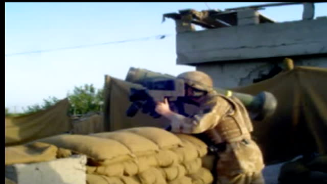 british troops email graphic video showing reality of war in afghanistan helmand province ext british soldiers in open terrain coming under attack... - helicopter rotors stock videos and b-roll footage