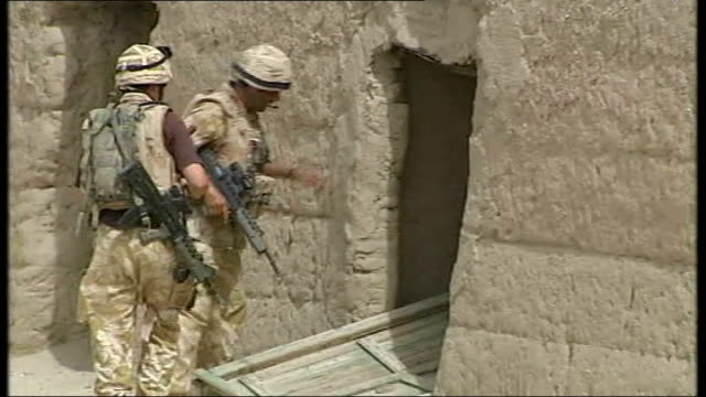 British troops helping to rebuild Sangin in Helmand Province April 2007 NATO soldiers checking exterior of damaged school building INT Damaged rooms...