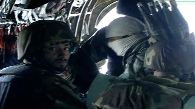 british troops in action in helmand province int soldiers from afghan national army sitting in back of helicopter in transit one wearing mask and... - afghan national army stock videos & royalty-free footage