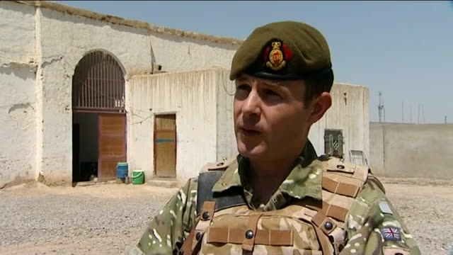 british troops in talks with local leaders in run up to planned 2015 handover; afghanistan: helmand province: nad ali: ext new afghan governor of nad... - provincial reconstruction team stock videos & royalty-free footage