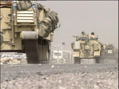 british troops in tanks move along dusty road past camera safwan iraq; mar 03 - britisches militär stock-videos und b-roll-filmmaterial