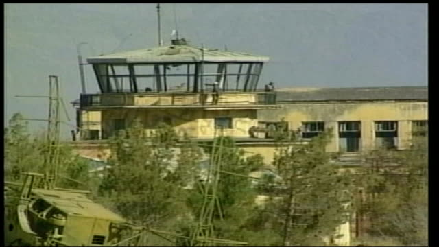 british troops injured; lib afghanistan: bagram: ext lms british soldiers in doorway of building dilapidated air control tower of airbase british... - bagram stock-videos und b-roll-filmmaterial