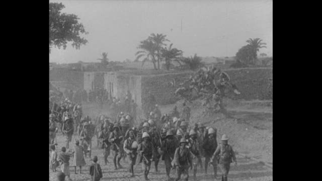 british troops marching on road near khan yunis in the gaza strip / french commander de piepape reviewing his troops in desert / de piepape with... - world war one stock videos & royalty-free footage