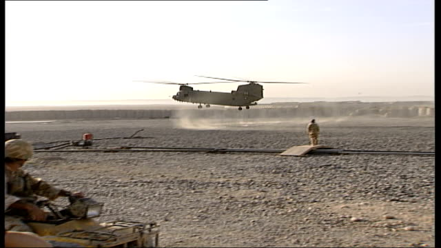 british troops on patrol and training afghan troops vars british chinook helicopters landing near air base/ vars british troops into chinook... - military base stock videos & royalty-free footage
