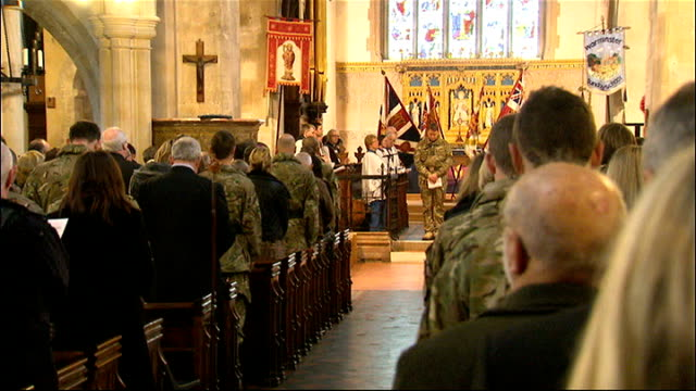 british troops prepare for deployment to afghanistan 3rd battalion the yorkshire regiment and members of congregation stand at service as last post... - battalion stock videos and b-roll footage