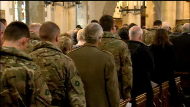 british troops prepare for deployment to afghanistan int soldiers of 3rd battalion the yorkshire regiment and members of congregation standing at... - battalion stock videos and b-roll footage