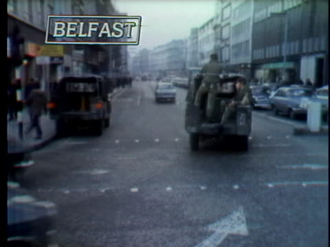 british troops ride in a jeep while patrolling the streets of belfast during a vote for northern ireland to keep ties with britain - 1973 stock videos & royalty-free footage