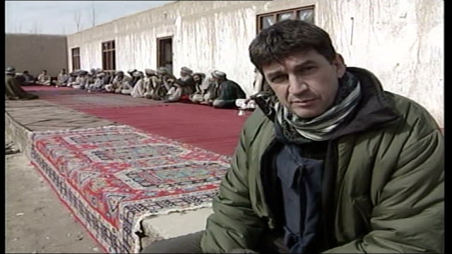 british troops to move south to tackle opium industry mazarisharif ext colonel mike mcmahon along to shake hands with local afghan mcmahon shaking... - man and machine stock videos & royalty-free footage