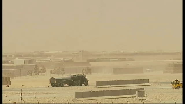 british troops working in extreme heat afghanistan helmand province camp bastion ext two soldiers send up meteorological weather balloon at midday to... - send stock videos and b-roll footage