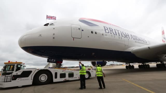 a british union flag flies from the cockpit of a new airbus a380 aircraft operated by british airways as it taxis after landing at heathrow airport... - cockpit stock videos & royalty-free footage