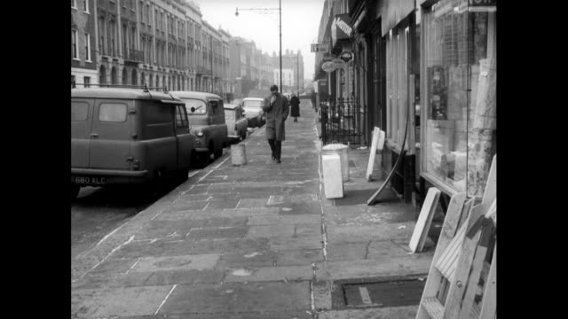 british urban street and old-fashioned shop fronts; 1963 - 1963 stock videos & royalty-free footage