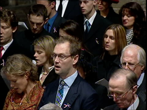 british victims memorial service bbc england london westminster westminster abbey int former us president george bush greeted on arrival for memorial... - memorial event stock videos and b-roll footage