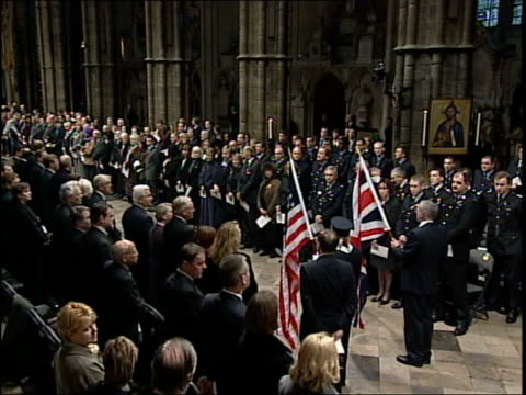 british victims memorial service bbc pool int queen entering abbey caileigh and kyle maddison whose father died in the world trade center presenting... - abbey stock videos & royalty-free footage