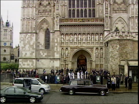 british victims memorial service itn ext queen placing bouquet on memorial for innocent victims people leaving abbey people gathered before memorial... - abbey stock videos & royalty-free footage