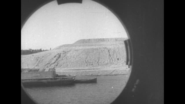 british warship docked near gibraltar / spanish soldiers firing artillery pieces on beach near gibraltar / aerial shot of barge next to shore / two... - horn of africa stock videos & royalty-free footage
