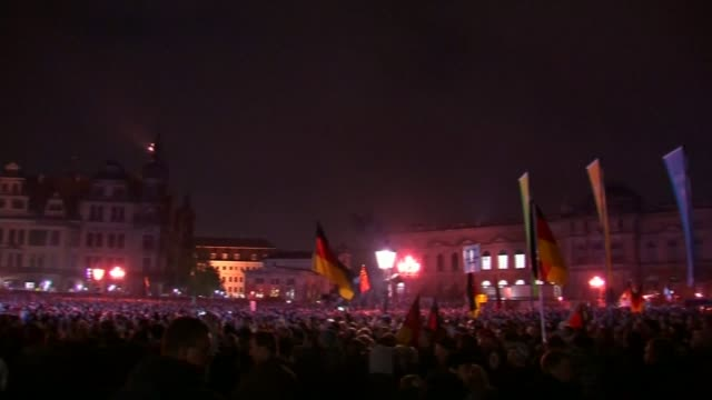 british wing of pegida anti-islam movement launched by former english defence league leader; t20101514 germany: saxony: dresden: ext / night gv... - dresden germany stock videos & royalty-free footage