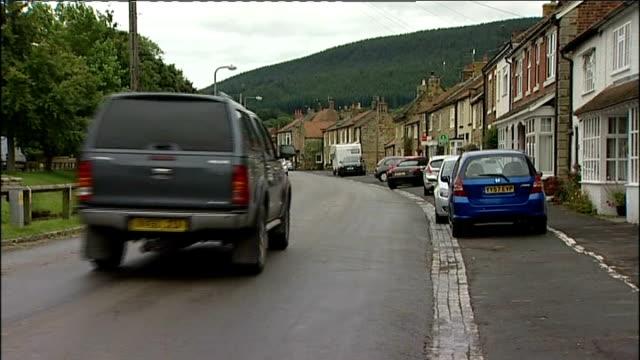 british woman shot dead in turkish holiday villa england north yorkshire swainby car along village street and past jennifer garbutt interview sot - リチャード・パロット点の映像素材/bロール