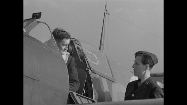 stockvideo's en b-roll-footage met montage british world war ii pilots land their fighter plane and report the number of enemy aircraft shot down to air communique intelligence officer / united kingdom - tweede wereldoorlog