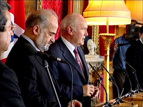 british/iraqi press conference: britain commits troops to stay in iraq; lancaster house: al-jaafari and john reid along to press conference podiums... - cut video transition stock videos & royalty-free footage
