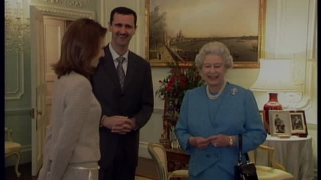briton known as 'jihadi jack' says he want to return to uk lib / tx london buckingham palace int bashar assad and his wife asma alassad standing with... - バッシャール・アル=アサド点の映像素材/bロール