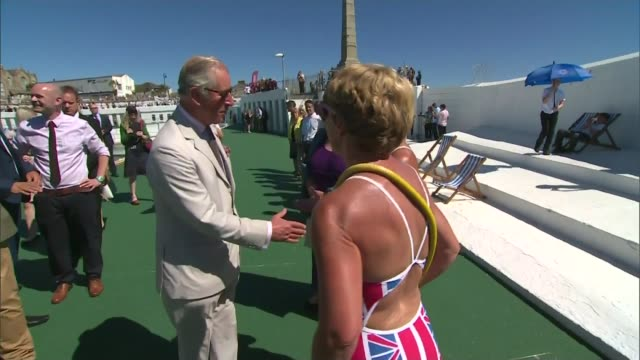 britons head to the seaside on the hottest day of the year so far; cornwall: penzance: ext prince charles puts on sunglasses as he shakes hands with... - ペンザンス点の映像素材/bロール