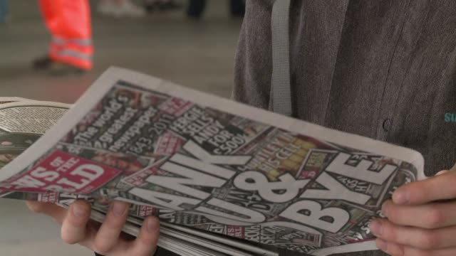 britons rushed to buy the final copy of the news of the world newspaper sunday, putting aside for a moment their disgust at the phone-hacking scandal... - news of the world stock videos & royalty-free footage