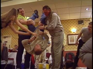 vídeos y material grabado en eventos de stock de brits love their beer and one contest makes participants down their suds upside down! - concursante