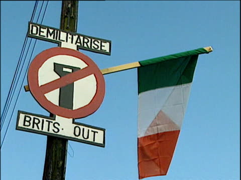 'brits out' sign on lamp post with irish tricolour south armagh; 2001 - county armagh stock videos and b-roll footage