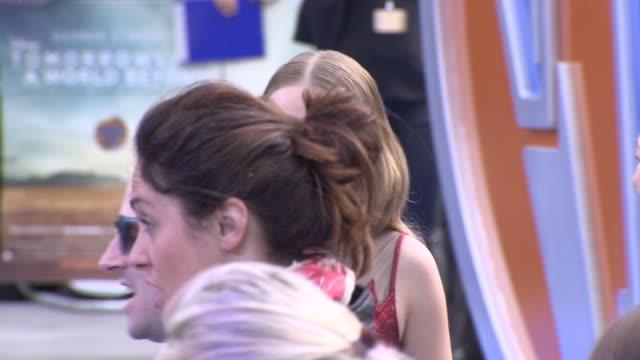 britt robertson at 'tomorrowland': a world beyond uk premiere - 赤のドレス点の映像素材/bロール