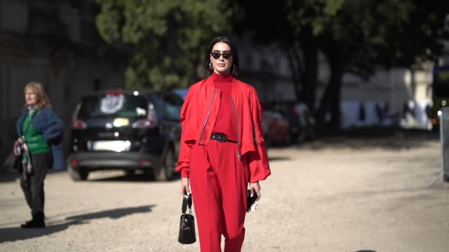 brittany xavier wears sunglasses a red turtleneck a black belt red pants an orange bomber jacket outside unravel project during paris fashion week... - turtleneck stock videos & royalty-free footage