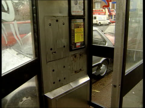 police studying cctv footage for evidence england london eltham ext telephone box from which call was made claiming that brixton nail bomb was... - dust stock videos & royalty-free footage