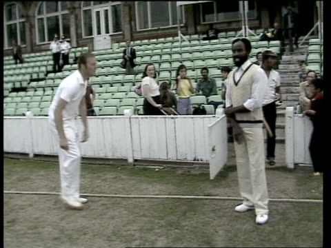 brixton police play brixton west indies eleven england london the oval ms west indian in dressing room tms pan players in dressing room kit up ms... - cricket bowler stock videos and b-roll footage