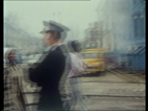 stockvideo's en b-roll-footage met london brixton bv pan police in groups along street with shields bv ditto bv police run along road bv move in with shields eng bv ditto zoom in bv... - 1981