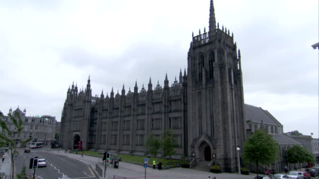 broad street traffic passes marischal college in aberdeen, scotland. available in hd. - aberdeen scotland stock videos & royalty-free footage